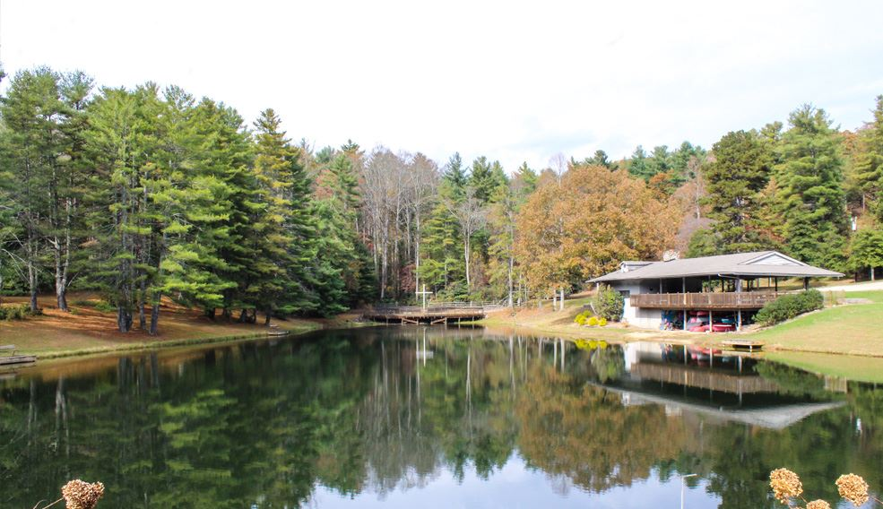 fall season lake view with parking garage and patio shelter to the right edge of the lake and photo.